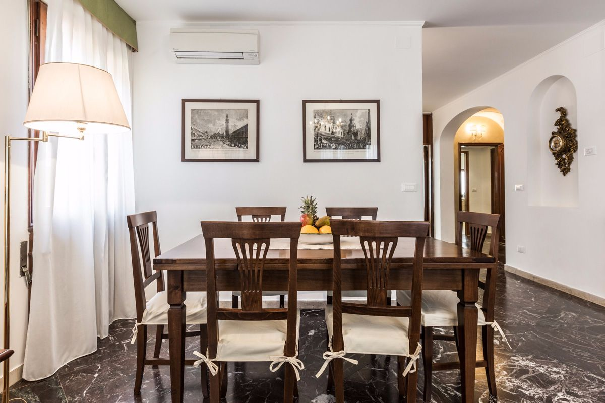 there are 2 dining tables: one in the living room and one in the kitchen