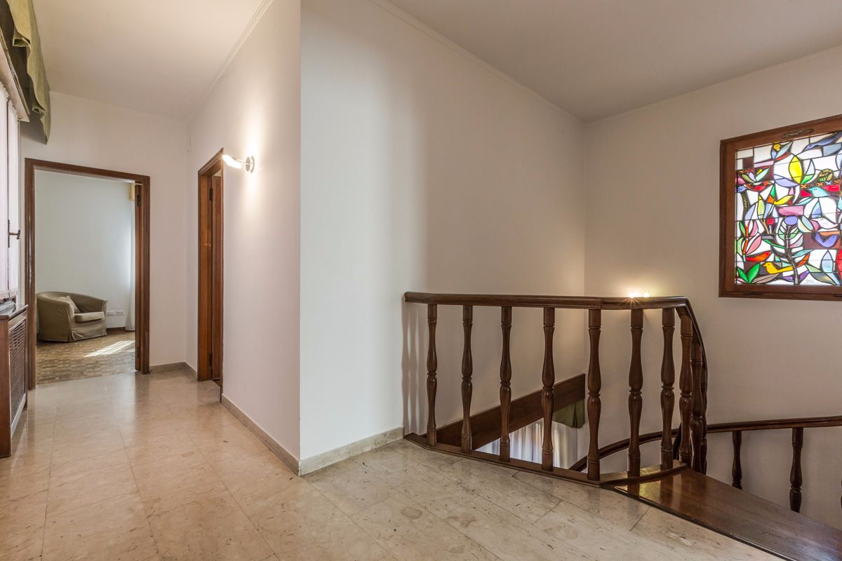 throught a corridor to the master bedroom