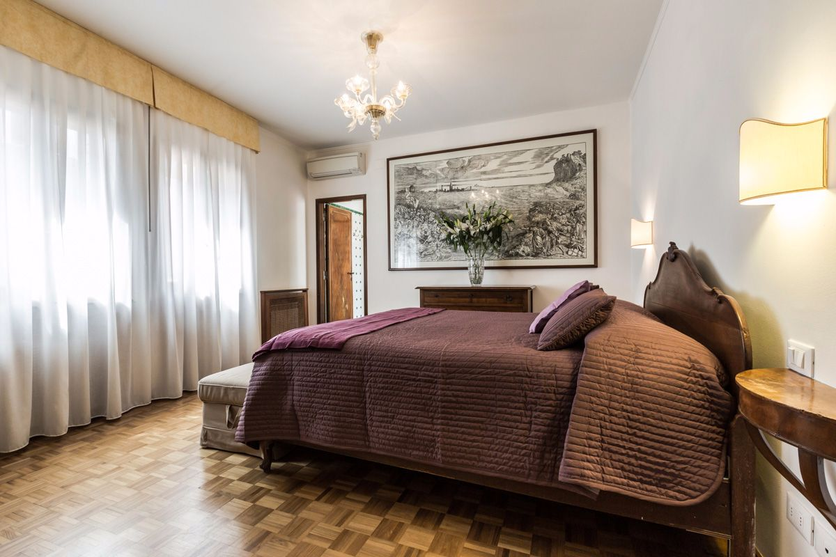 the spacious master bedroom with canal view and en-suite bathroom