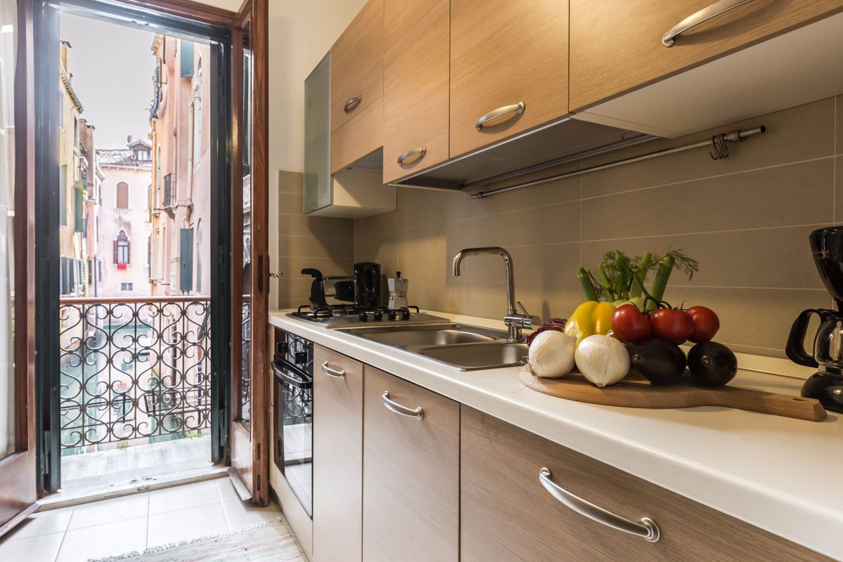 nice kitchen with balcony facing a picturesque canal