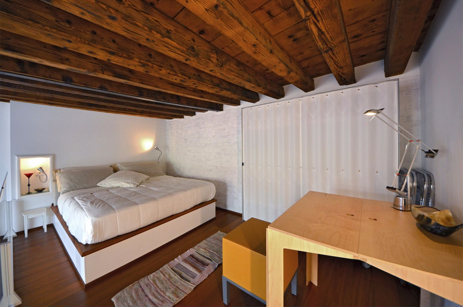 spacious bedroom in the gallery, the height of the wooden beams is 185 cm