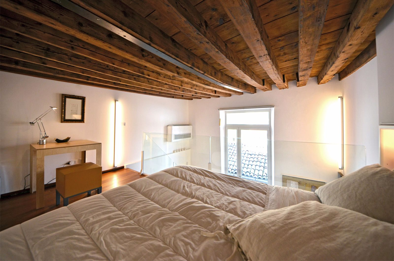 it is furnished with queen size bed, wardrobe, desk