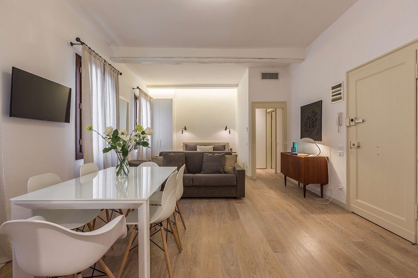 some vintage designer furniture blend with brand new wooden floor
