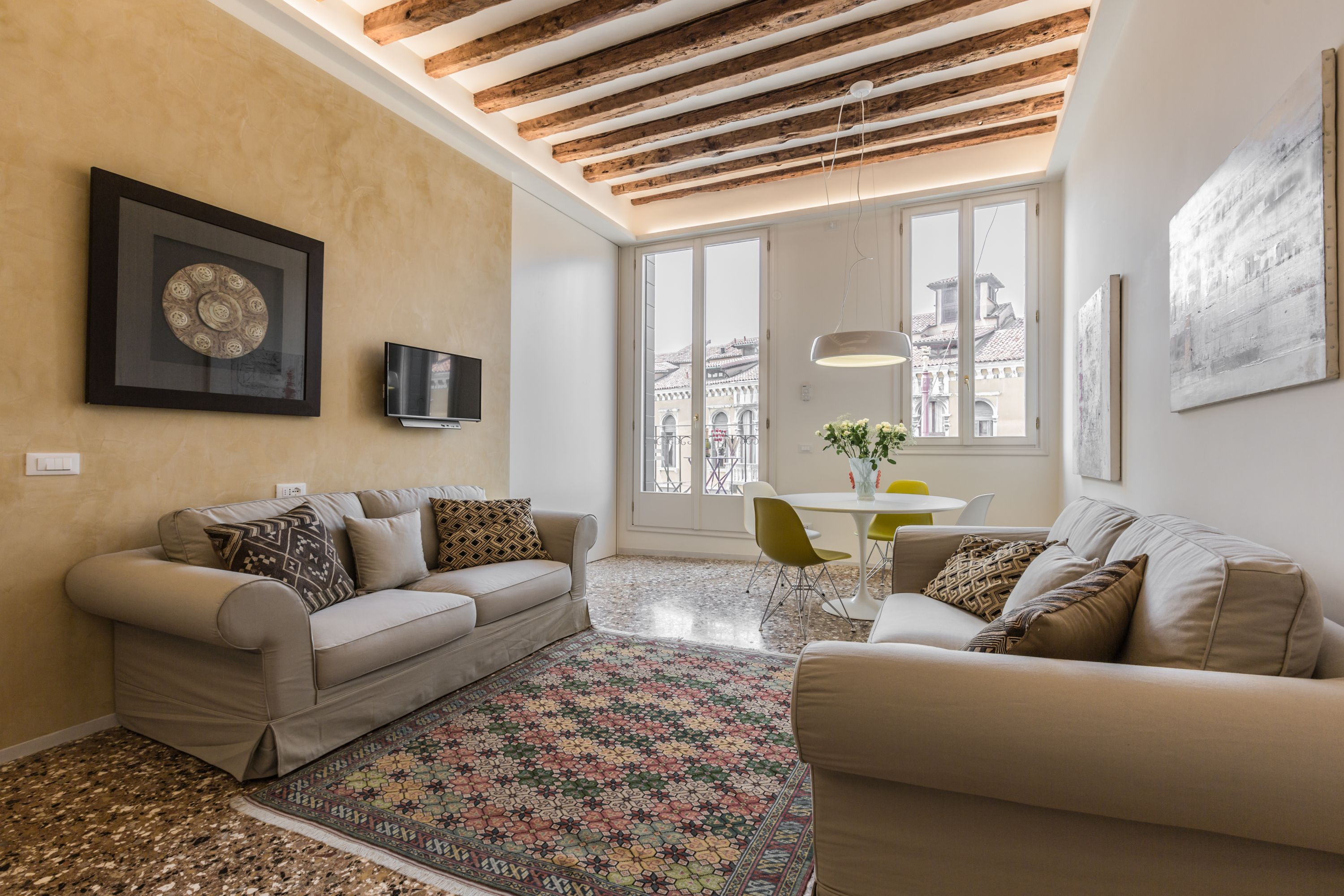 comfortable sofas, terrazzo Veneziano flooring, antique wooden beamed ceiling, plenty of natural light