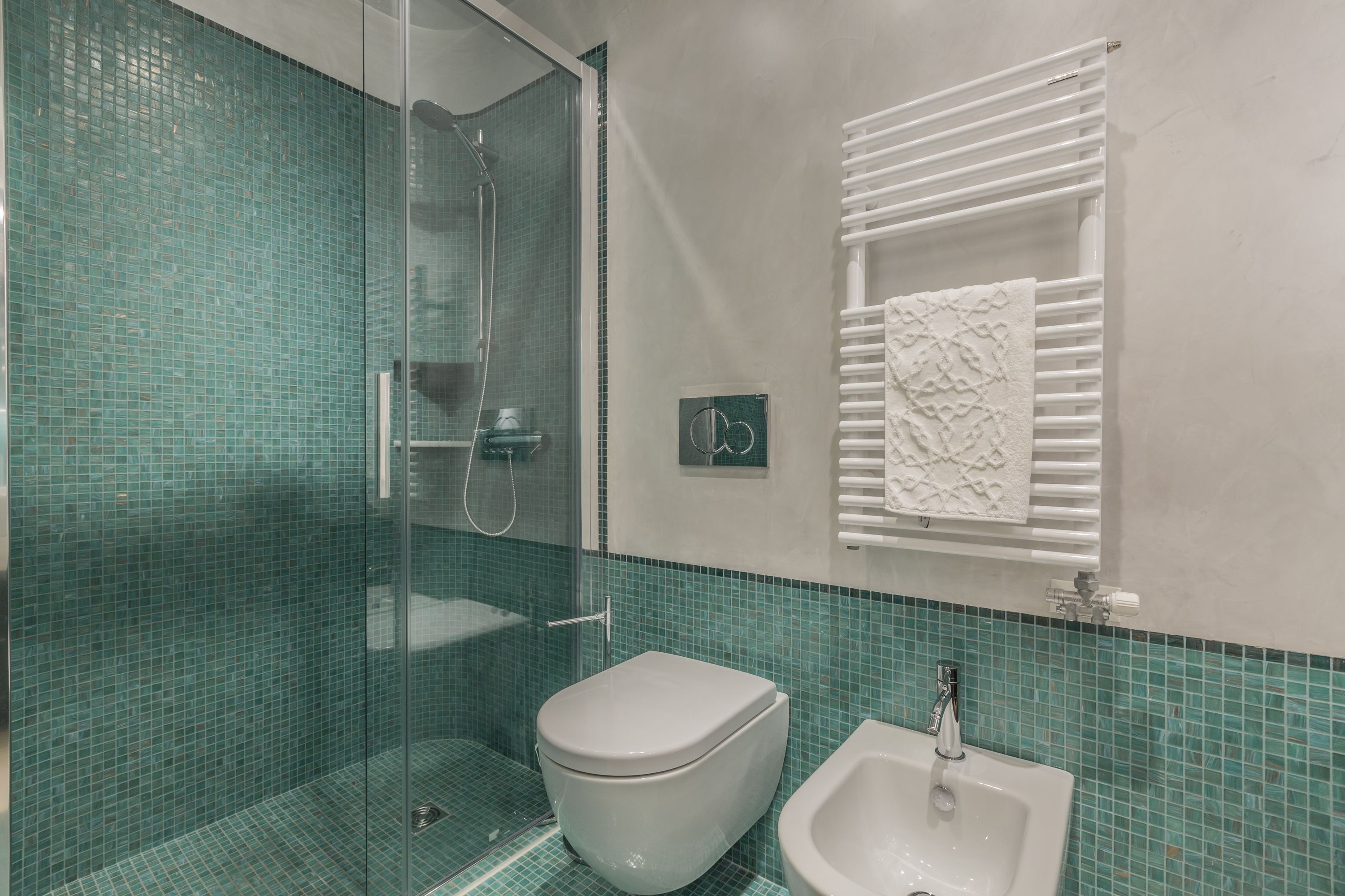 the second bathroom has a large shower box