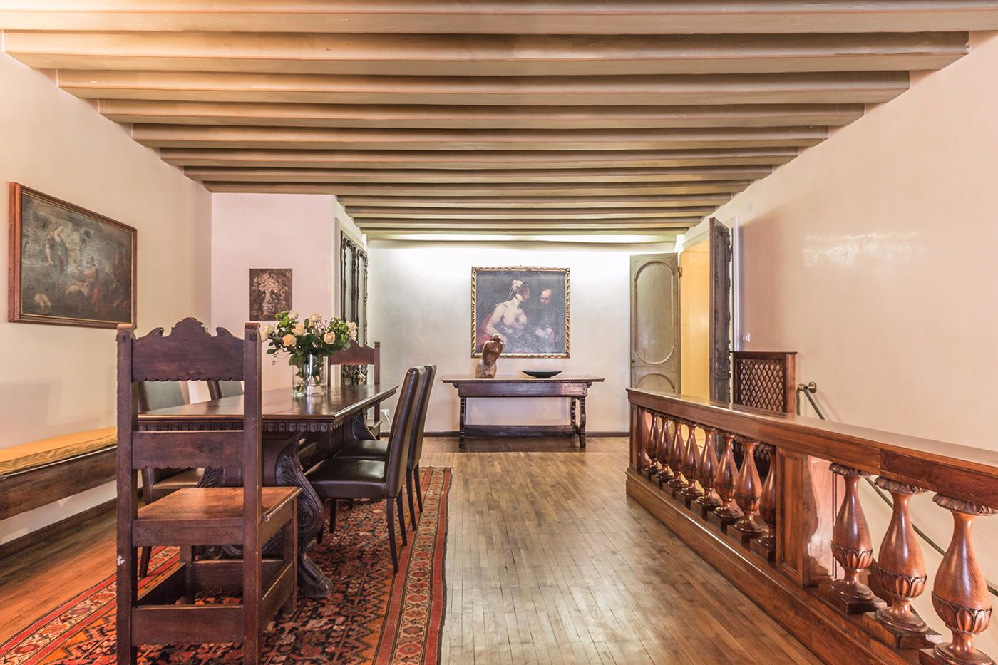 nice wooden beamed ceilings and natural parquet flooring confer warmth