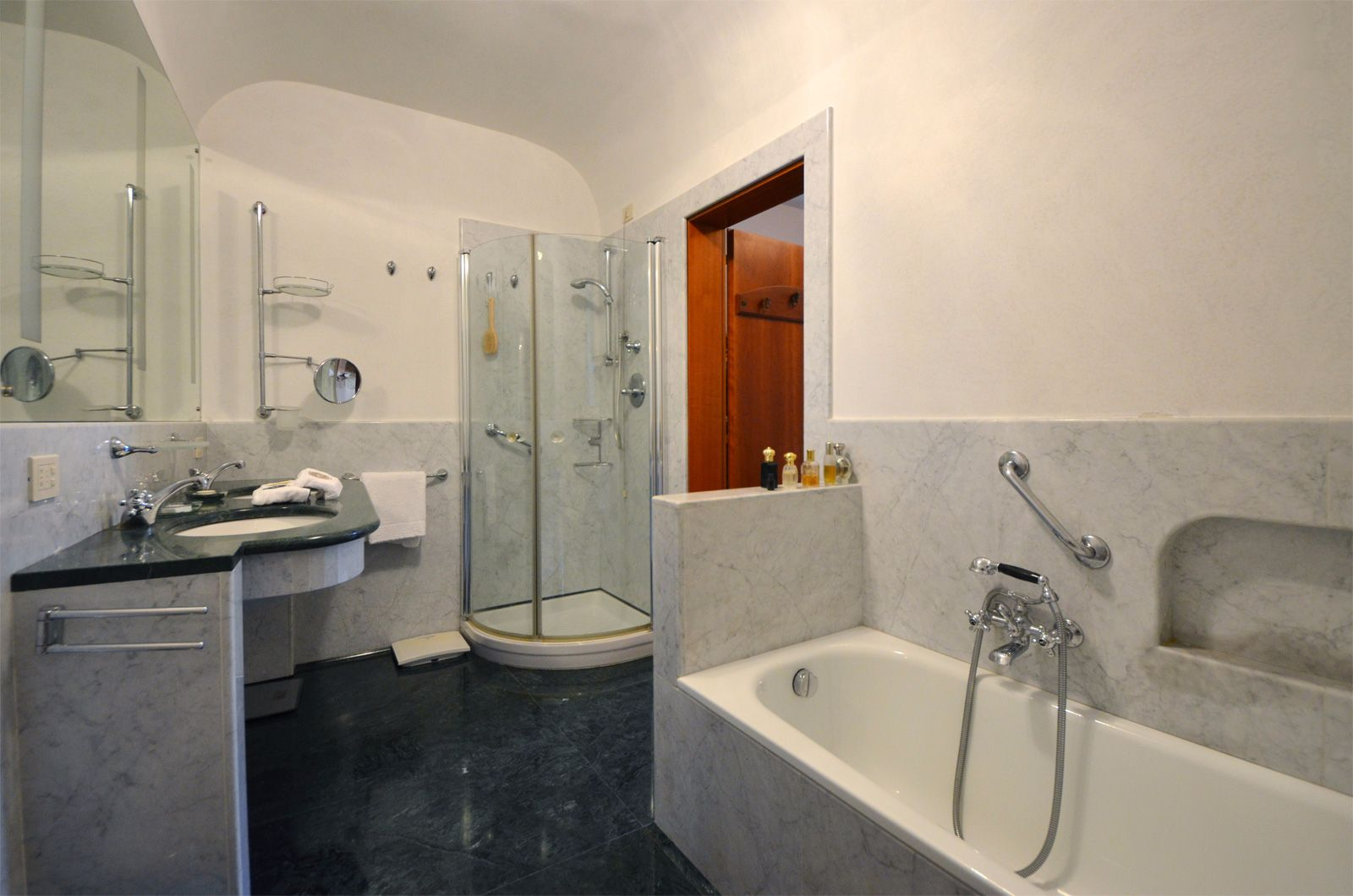 en-suite bathroom with bathtub and large shower cabin