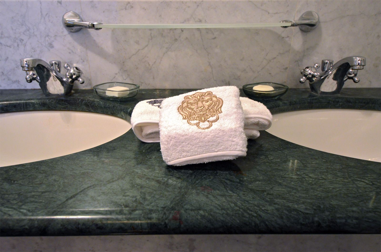 bathroom made with green and white marbles