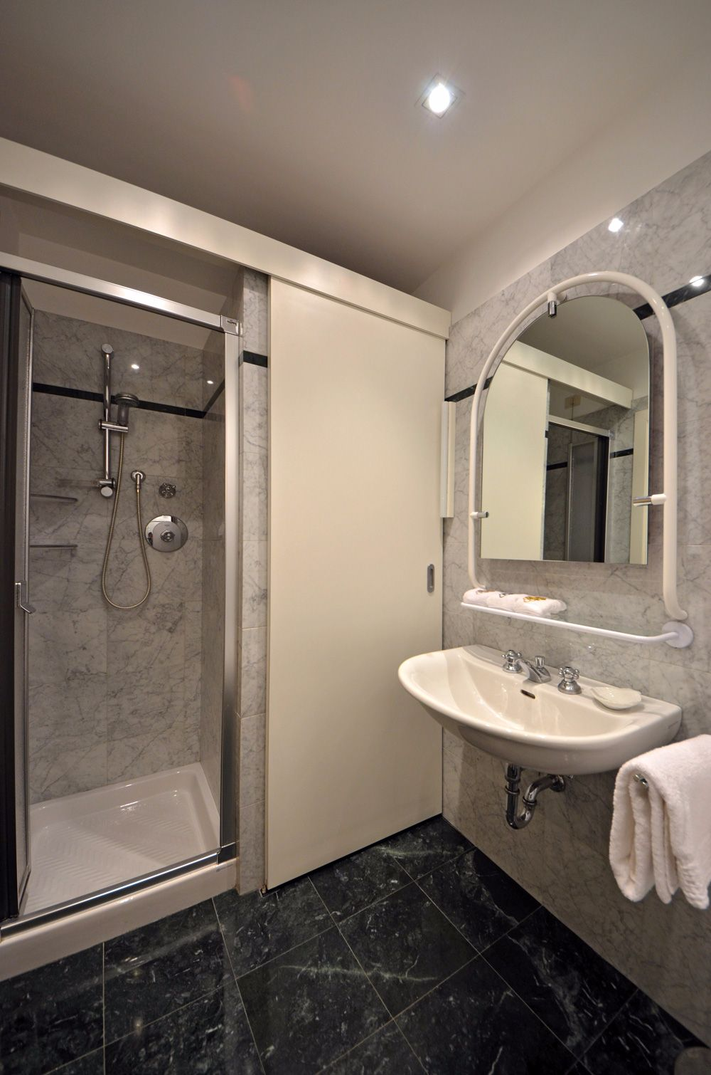 second smaller bathroom with shower