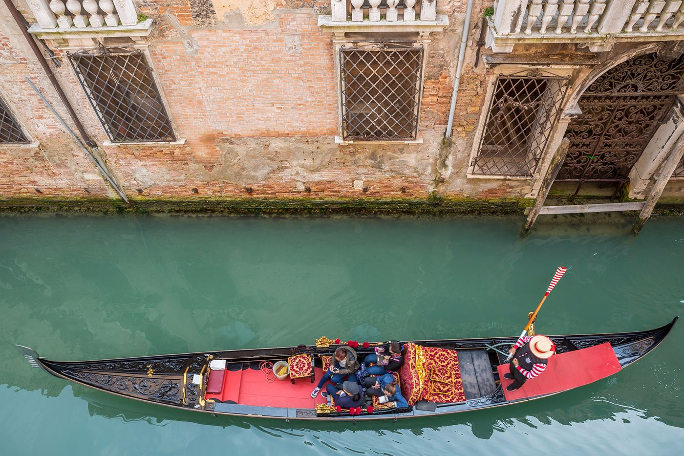 enjoy the serenades of the gondoliers rowing along the canal