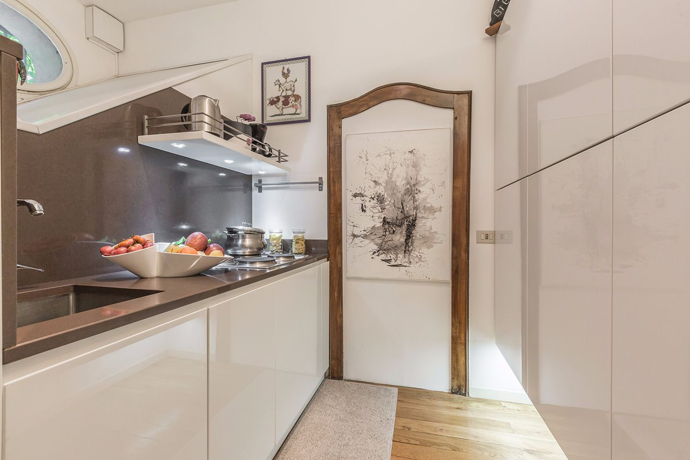 the kitchen has plenty of spacious cupboards on the right and the appliances on the left