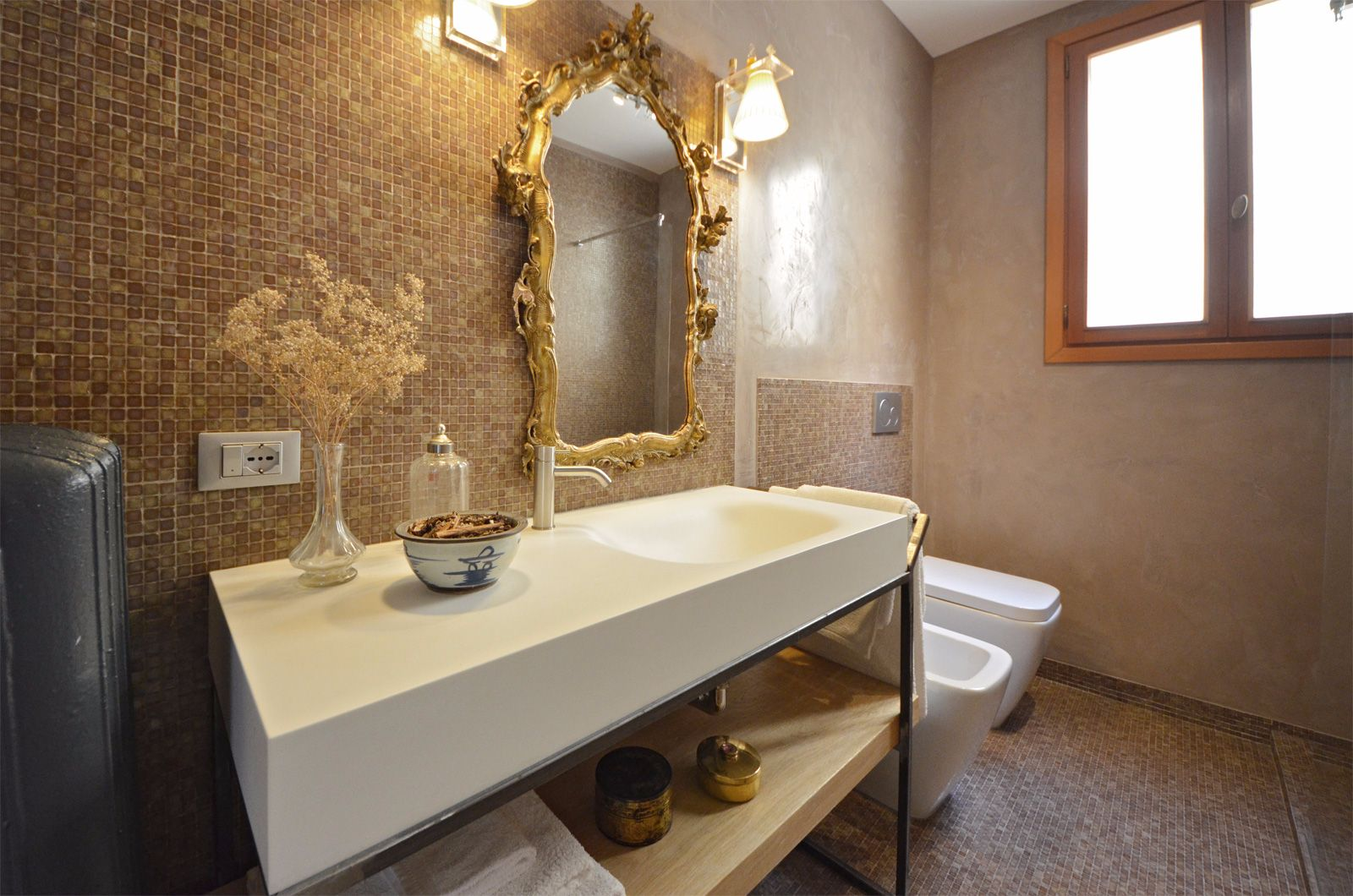 brand new bathroom with elegant mosaic tiles and designer vanities