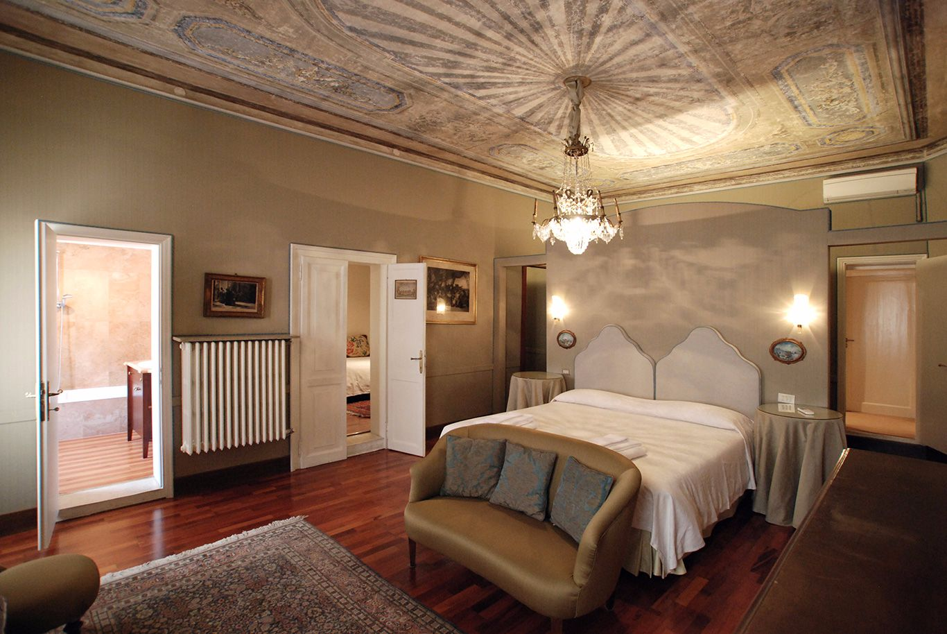 the beautiful master bedroom with frescoed ceiling and en-suite bathroom