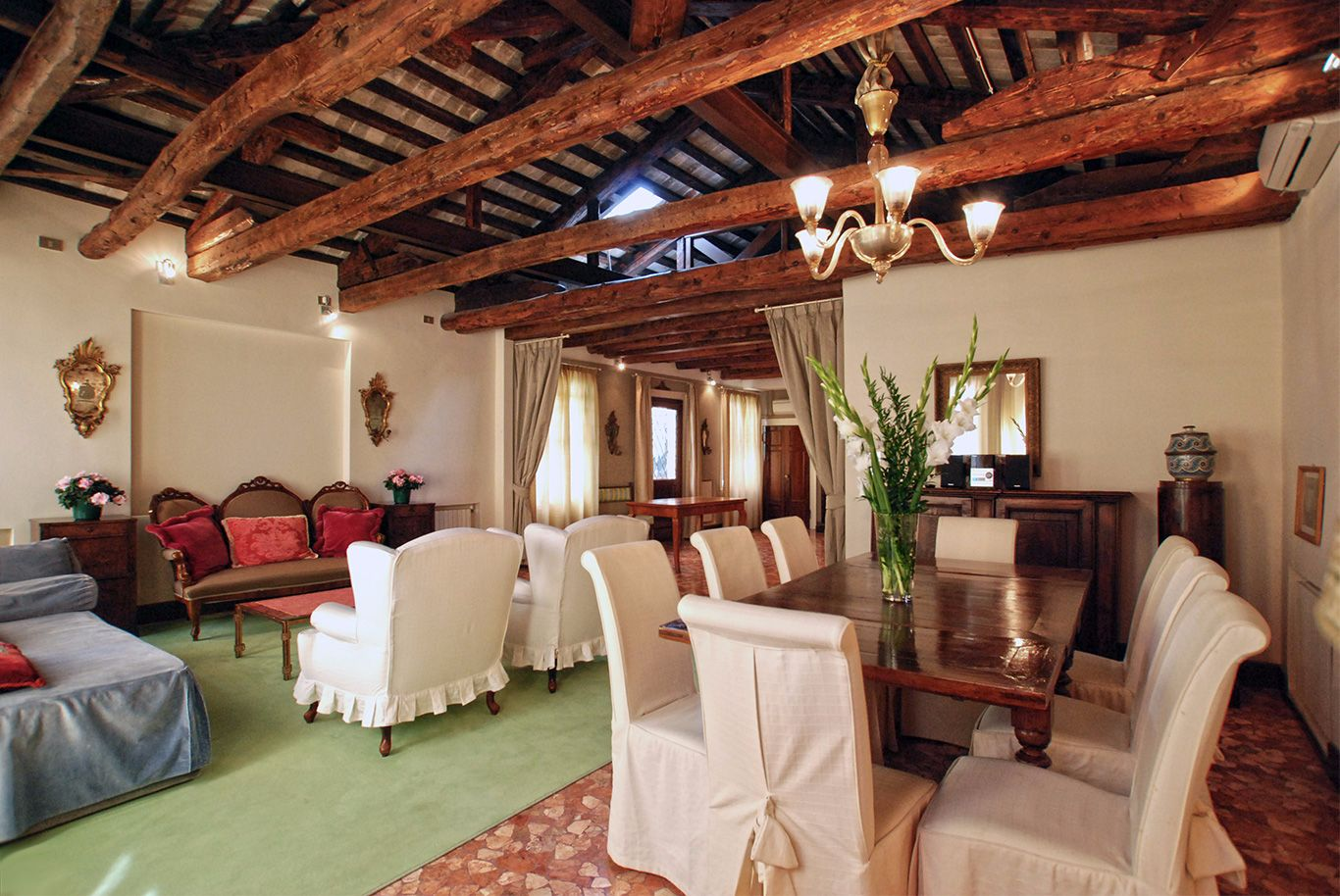 the living/dining area is truly Venetian with authentic furniture