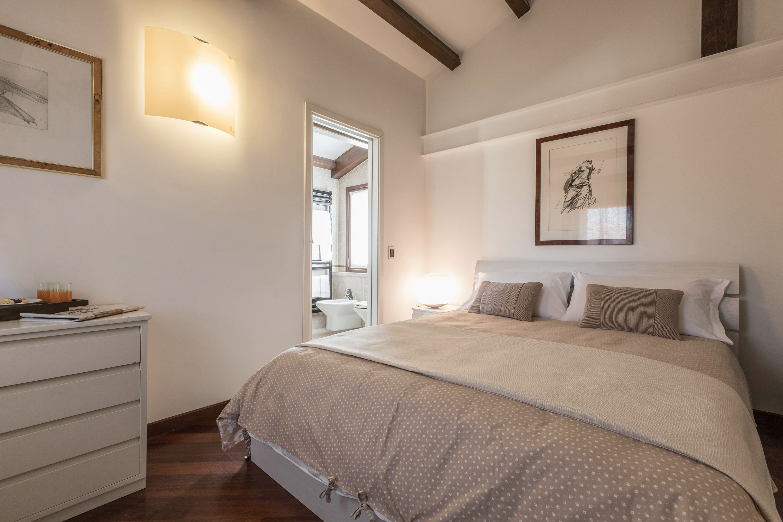 master bedroom with en-suite bathroom and wardrobe