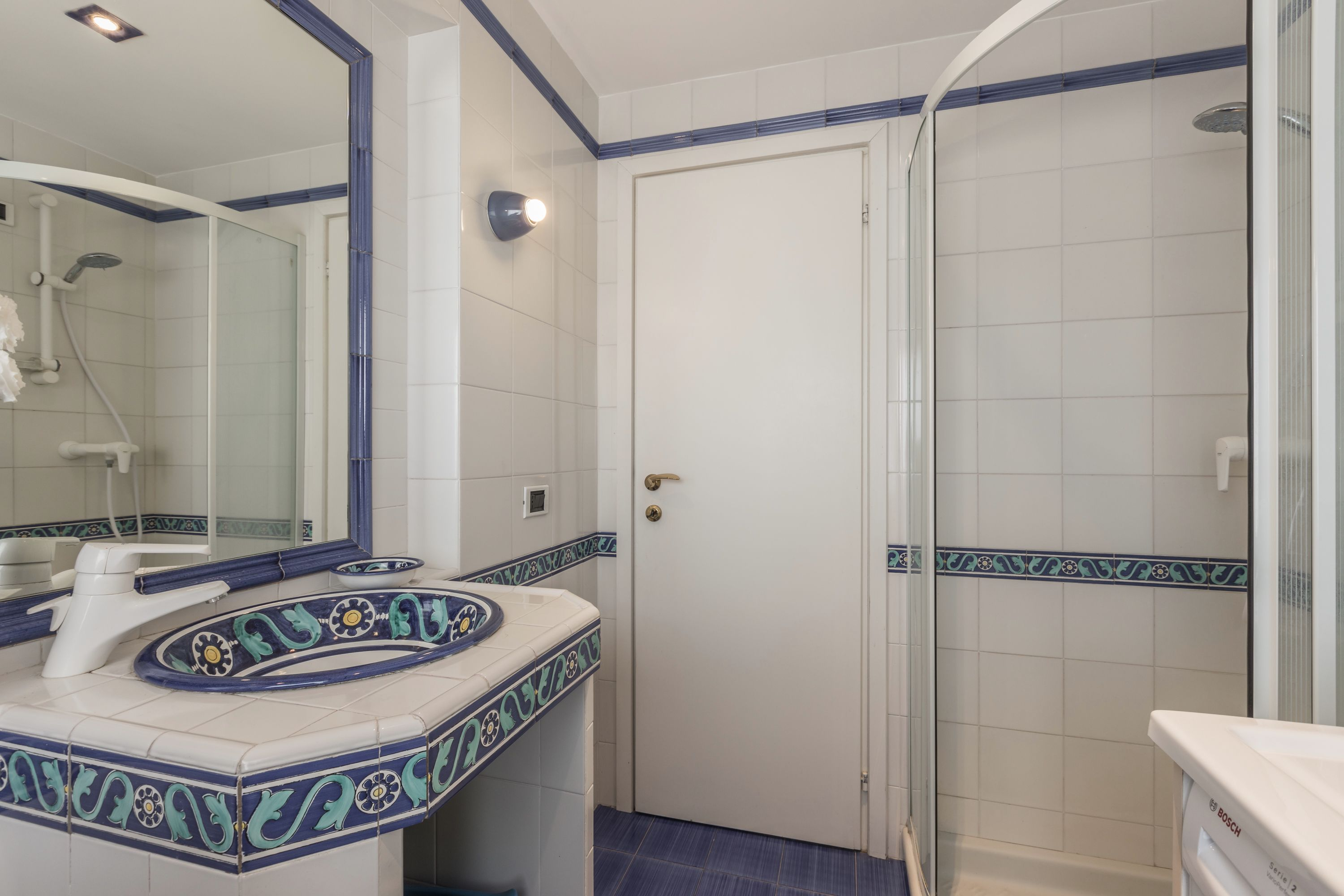 third bathroom with shower and washing machine