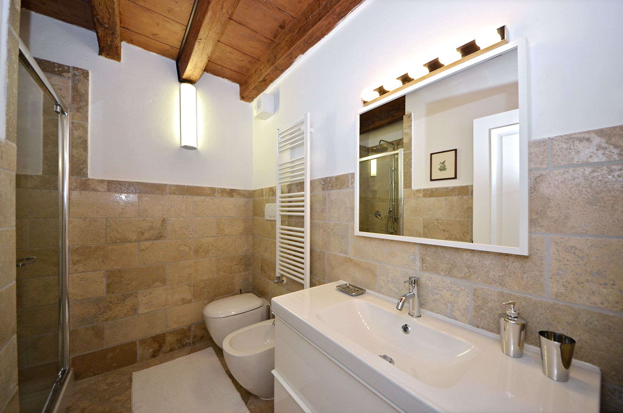 large bathroom with shower cabin