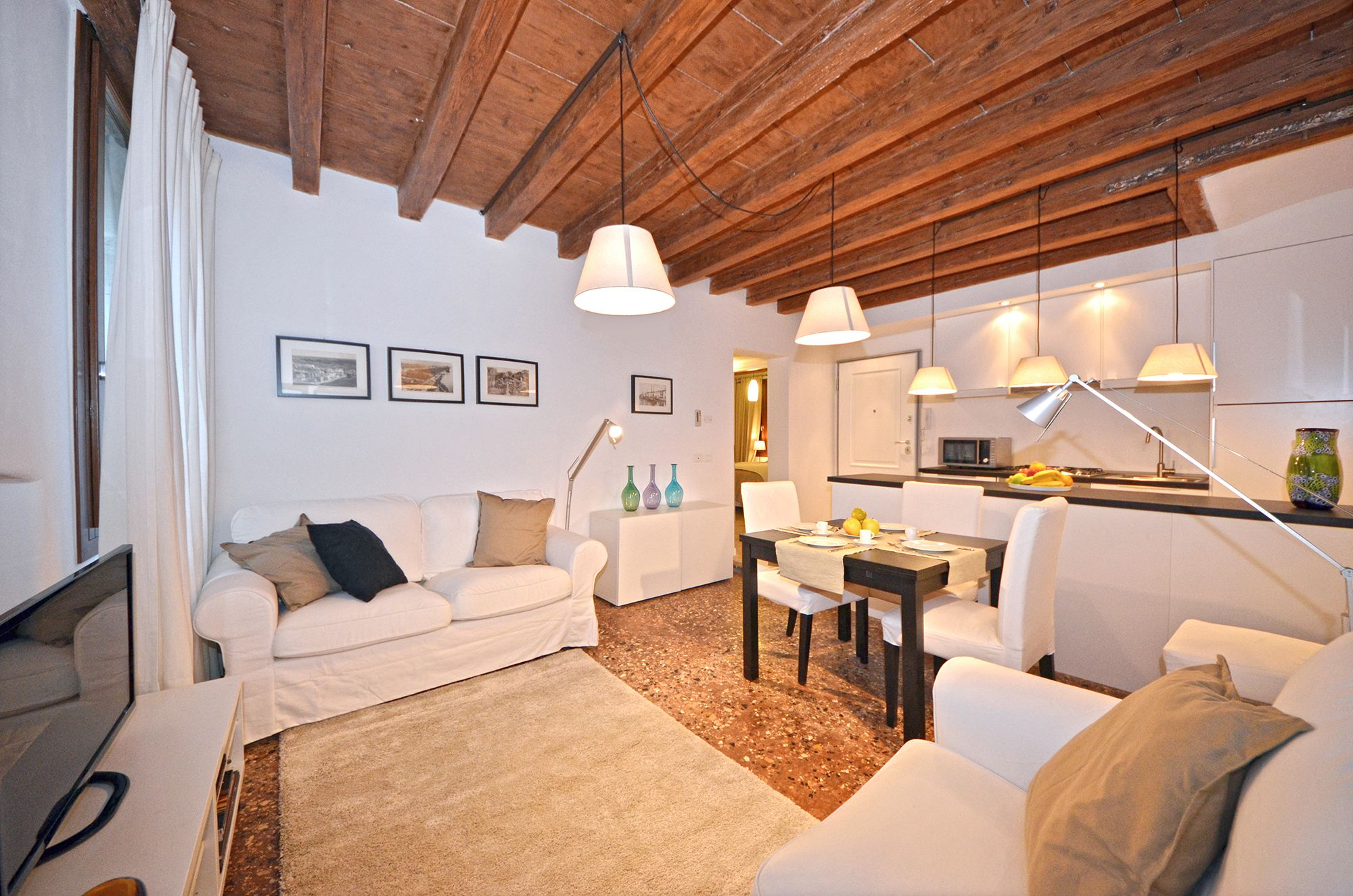 """antique wooden beamed ceilings and """"Terrazzo Veneziano"""" flooring"""