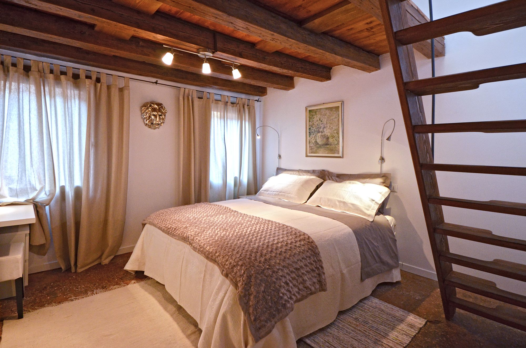the double bedroom has plenty of wardrobe space and a staircase to the attic