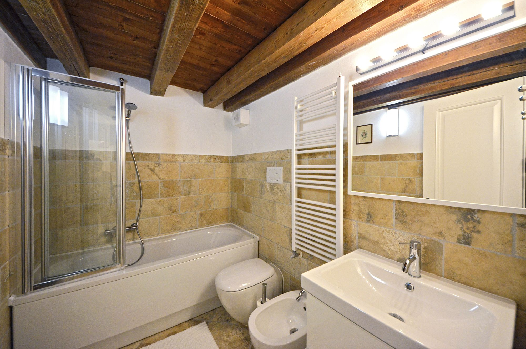nice bathroom with bathtub and shower screen