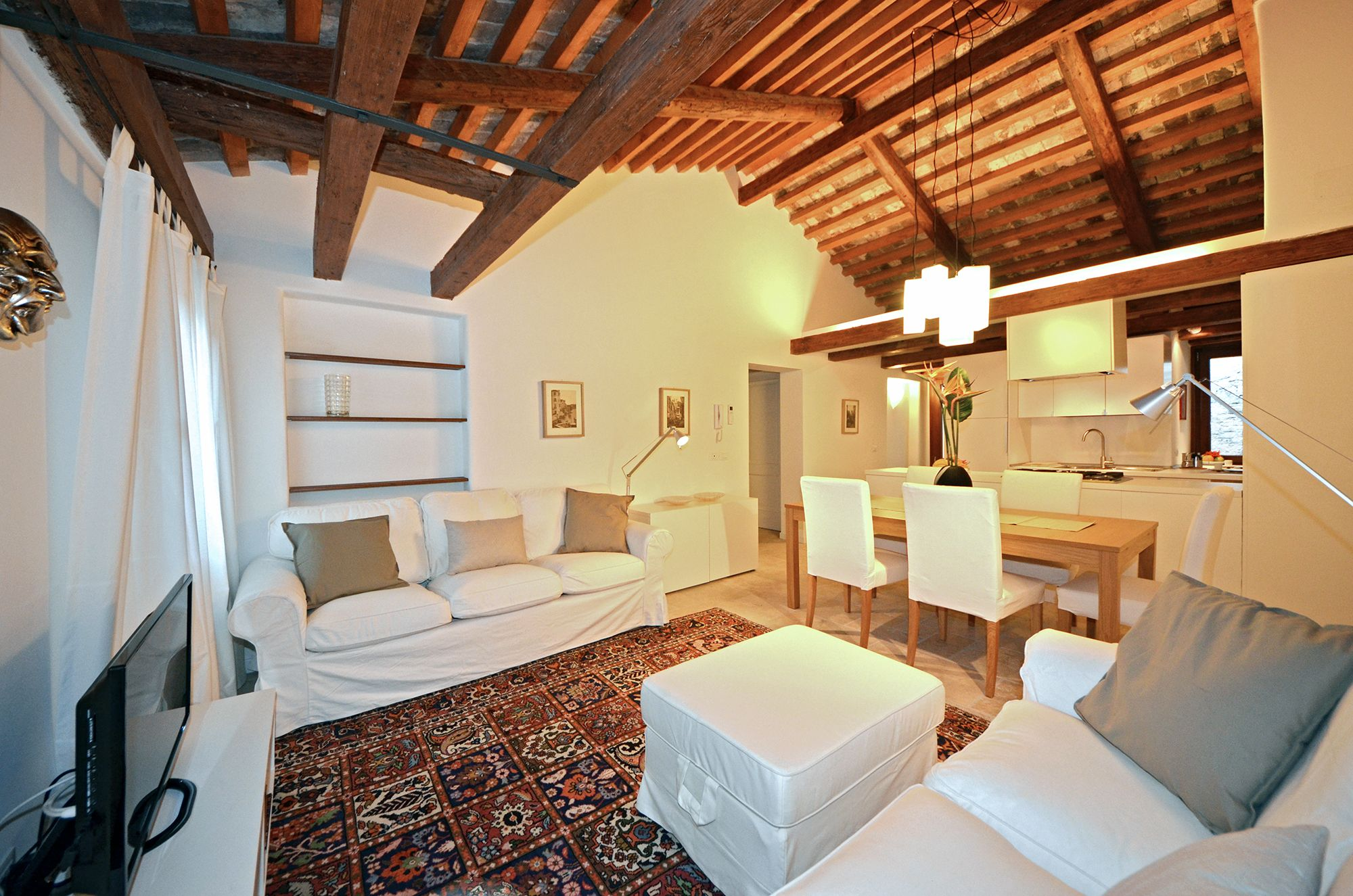 spacious living room with antique wooden beams