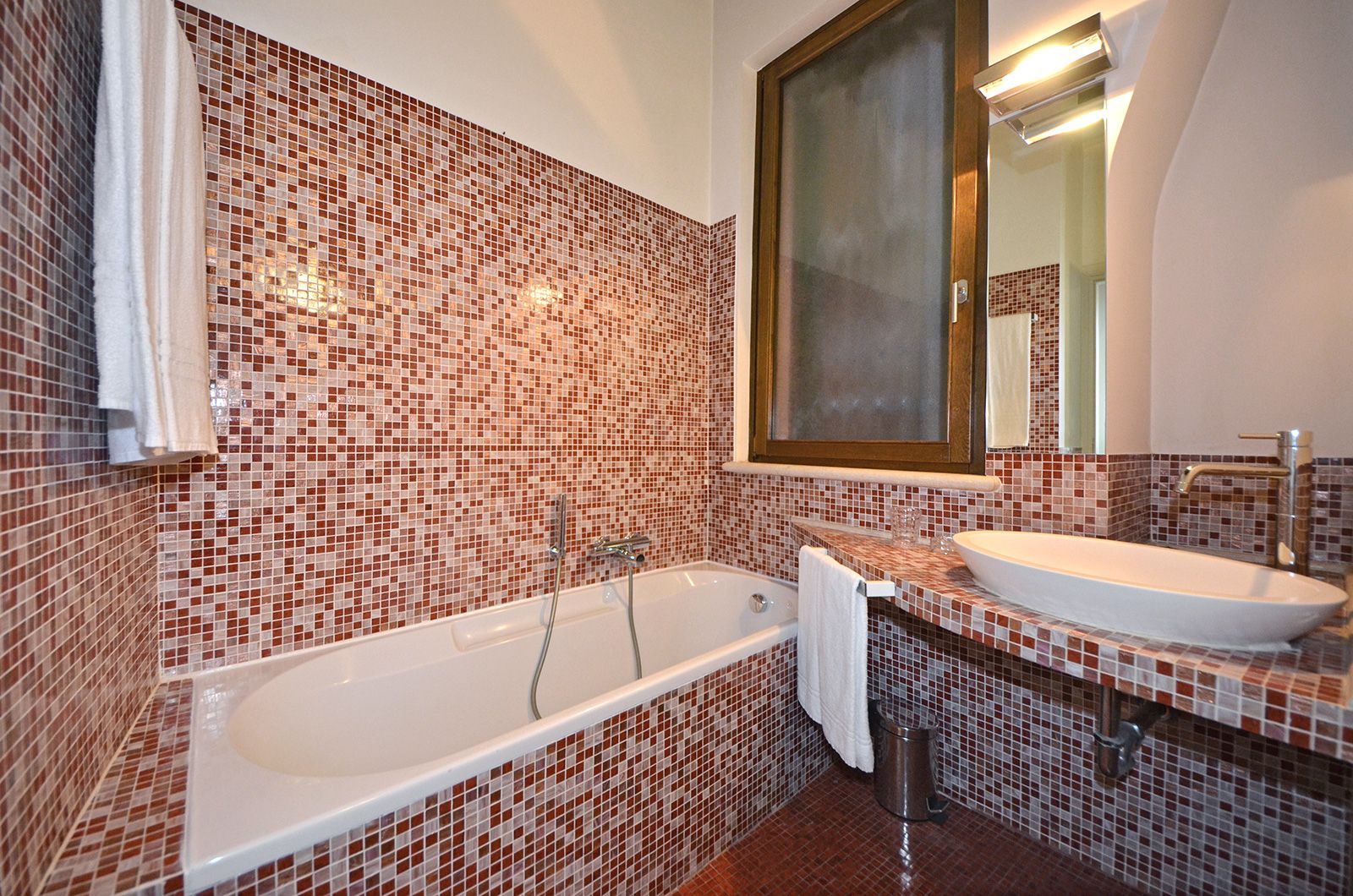 larger bathroom with bathtub
