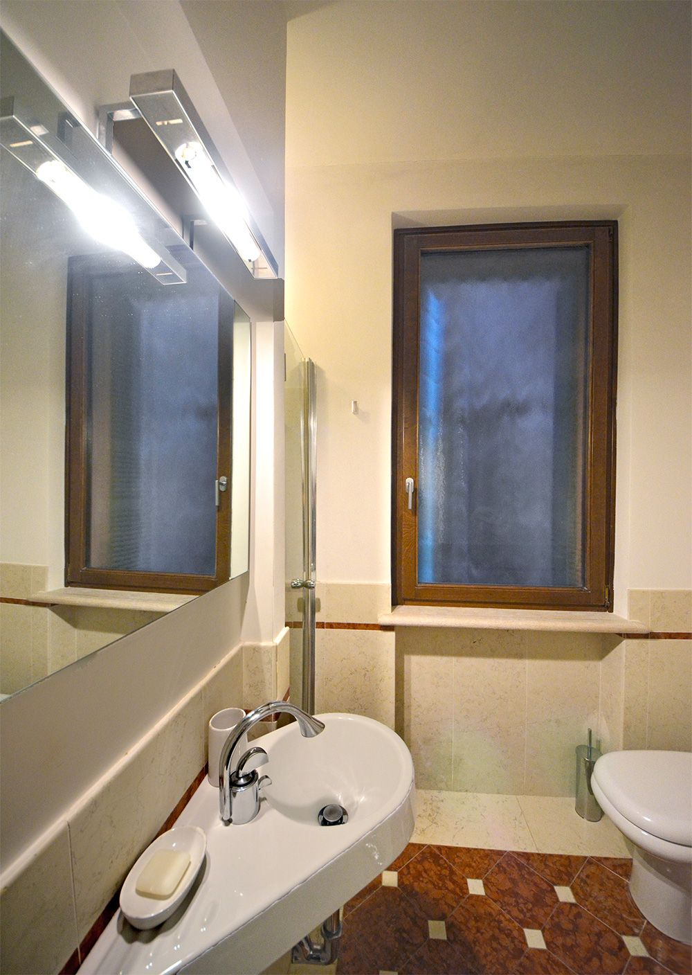 smaller bathroom with shower