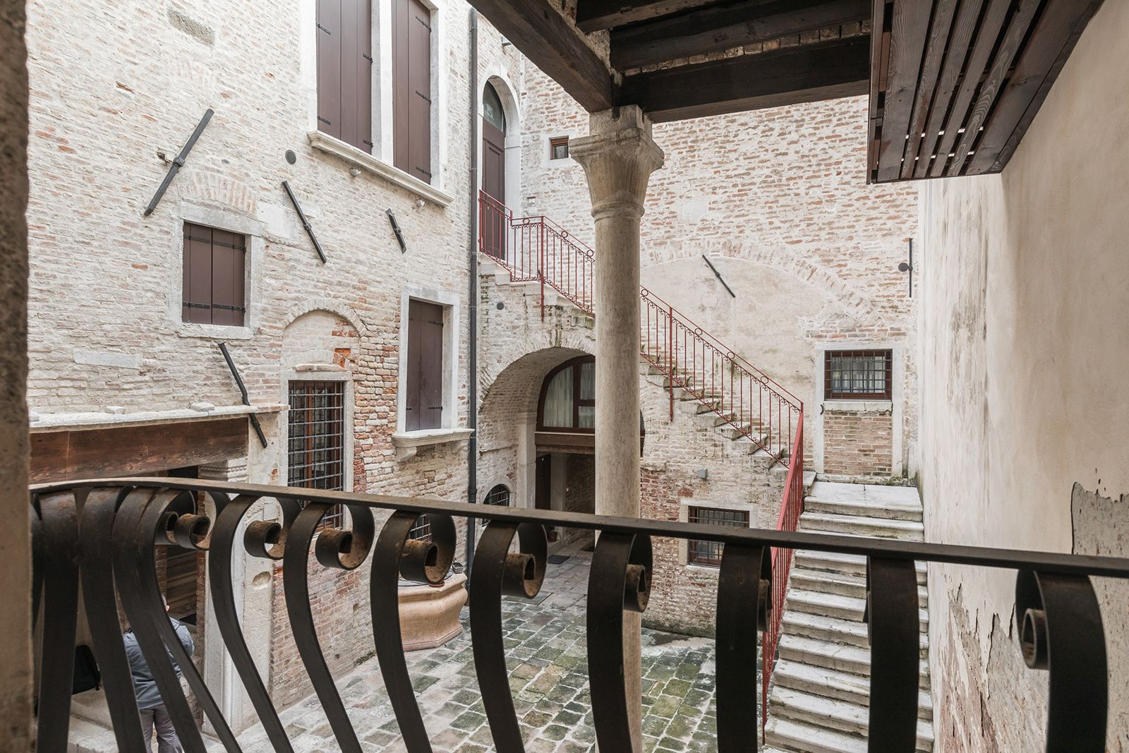 "there is a small ""Romeo & Juliet"" kind of balcony facing the charming courtyard of this historical Palazzo"