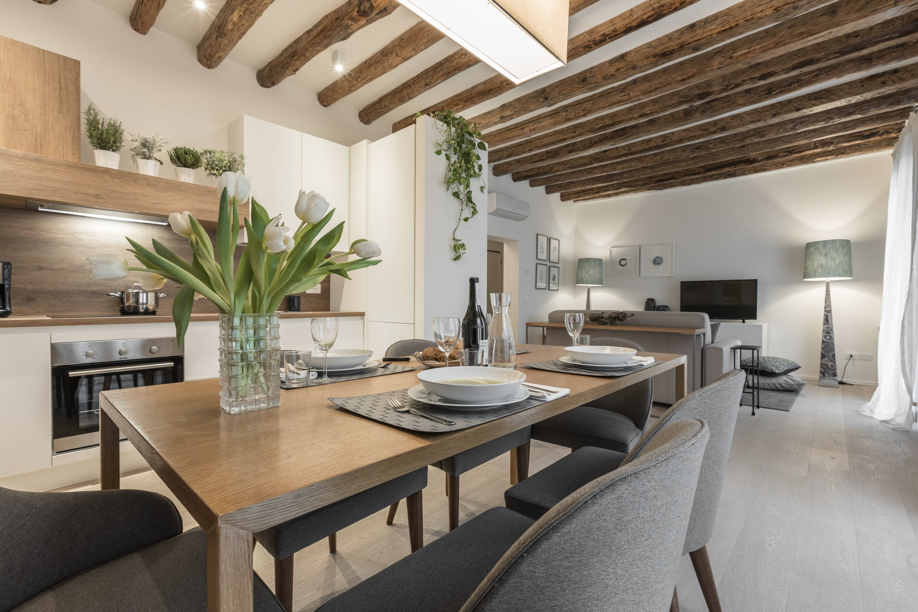 nice parquet flooring and antique wooden beamed ceiling confer warmth to the ambience