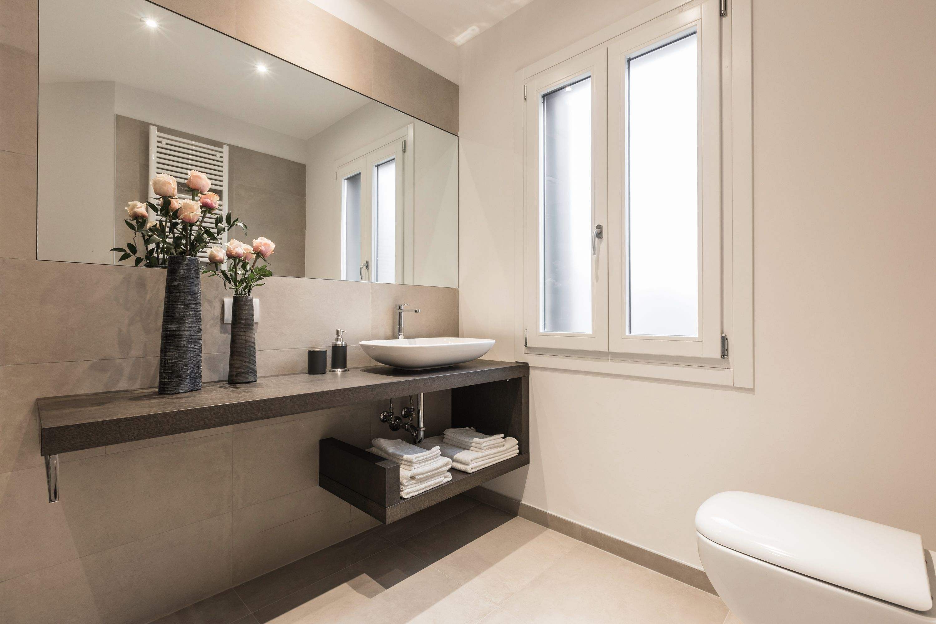 the main bathroom is large, stylish and bright...