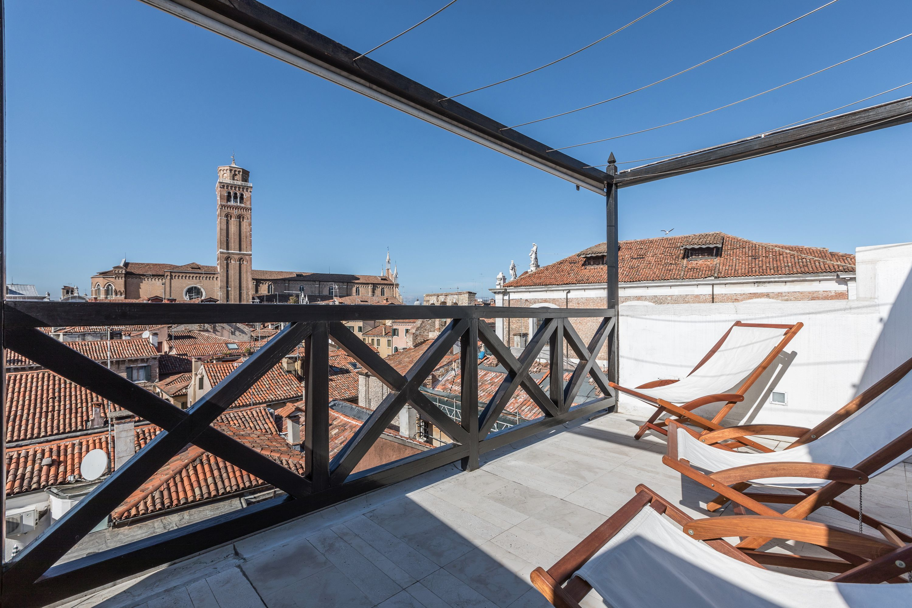 the Dandolo apartment panoramic terrace features a stunning view!