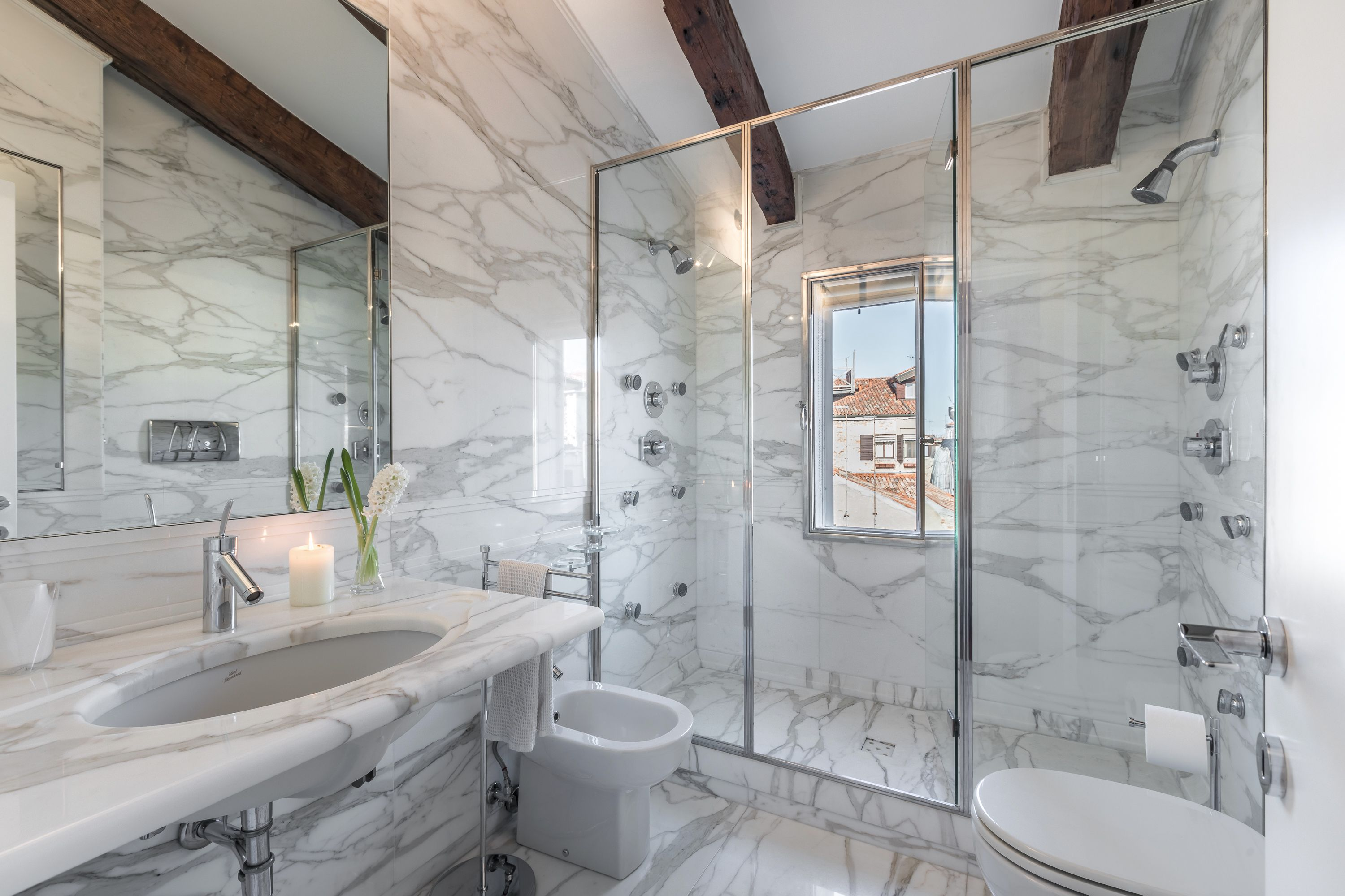 precious marble bathroom with large shower cabin