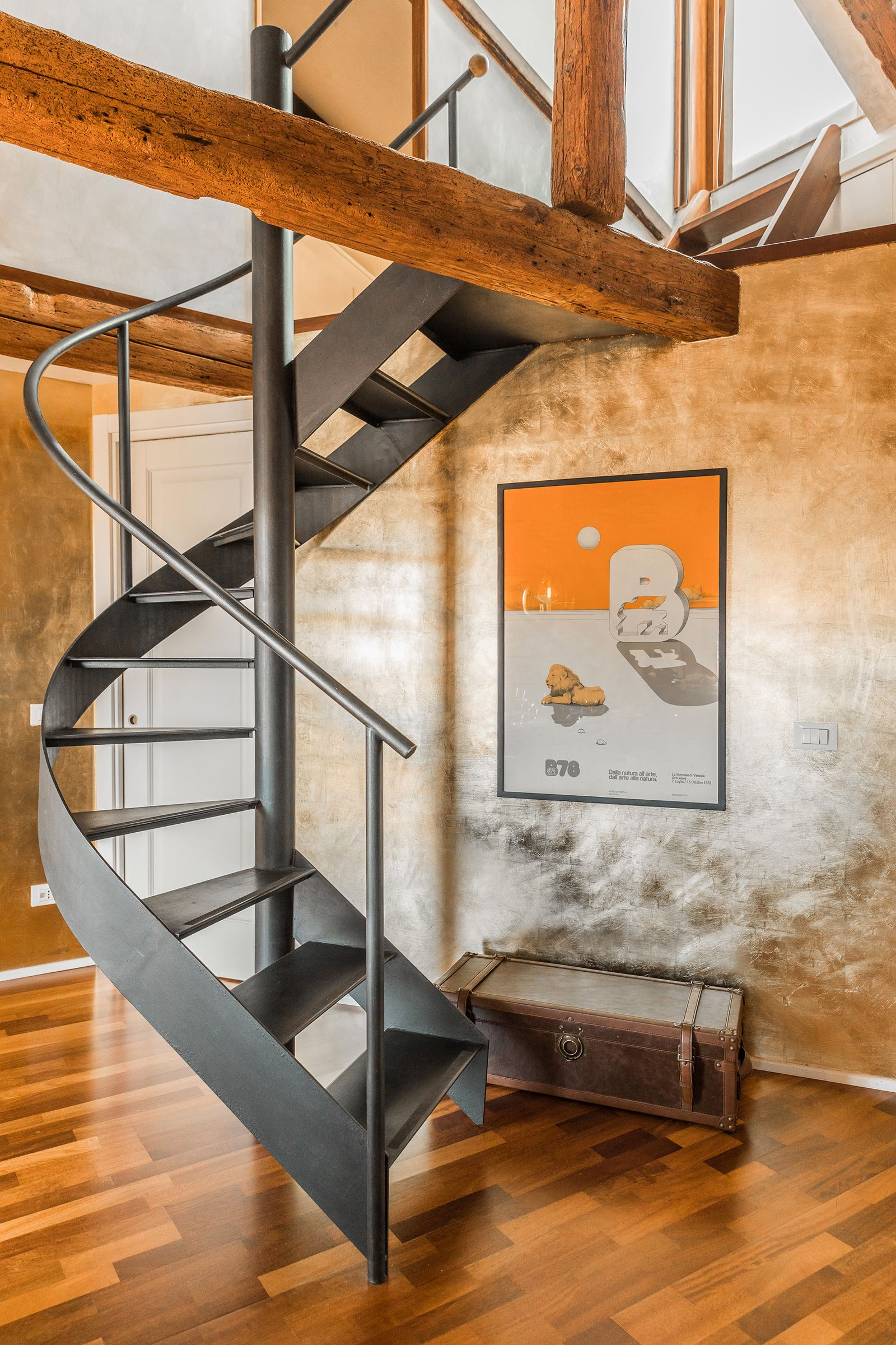 there is an easy to climb spiral staircase leading to a small gallery and the terrace