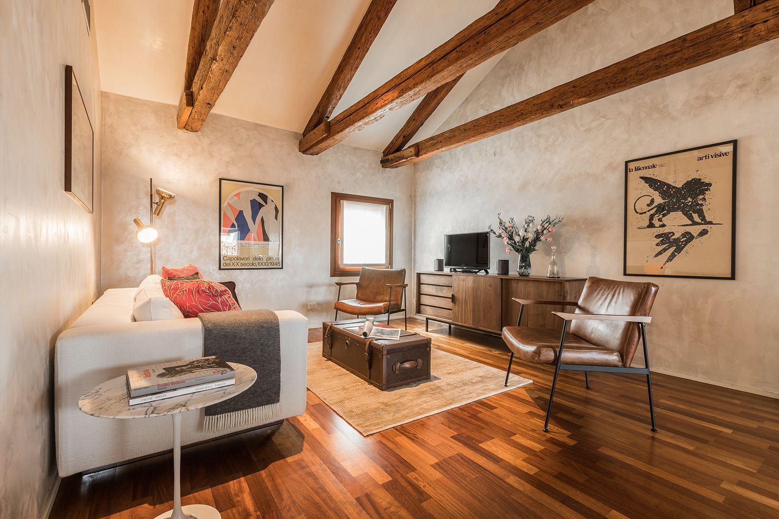 in the sitting room there is a comfortable double sofa-bed