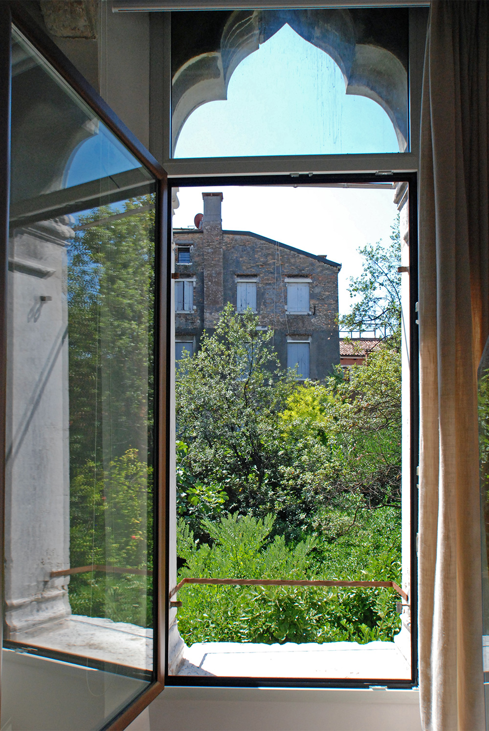 there is a little balcony on the ancient gothic window of the bedroom
