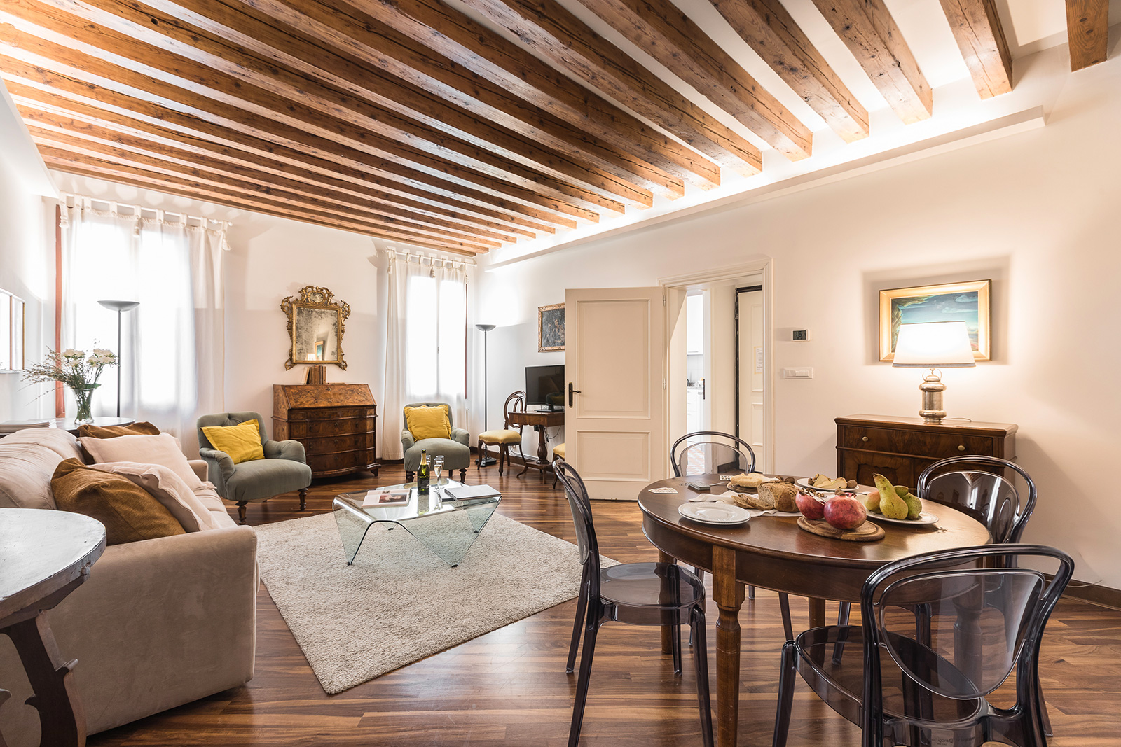 antique wooden beamed ceiling and parquet flooring