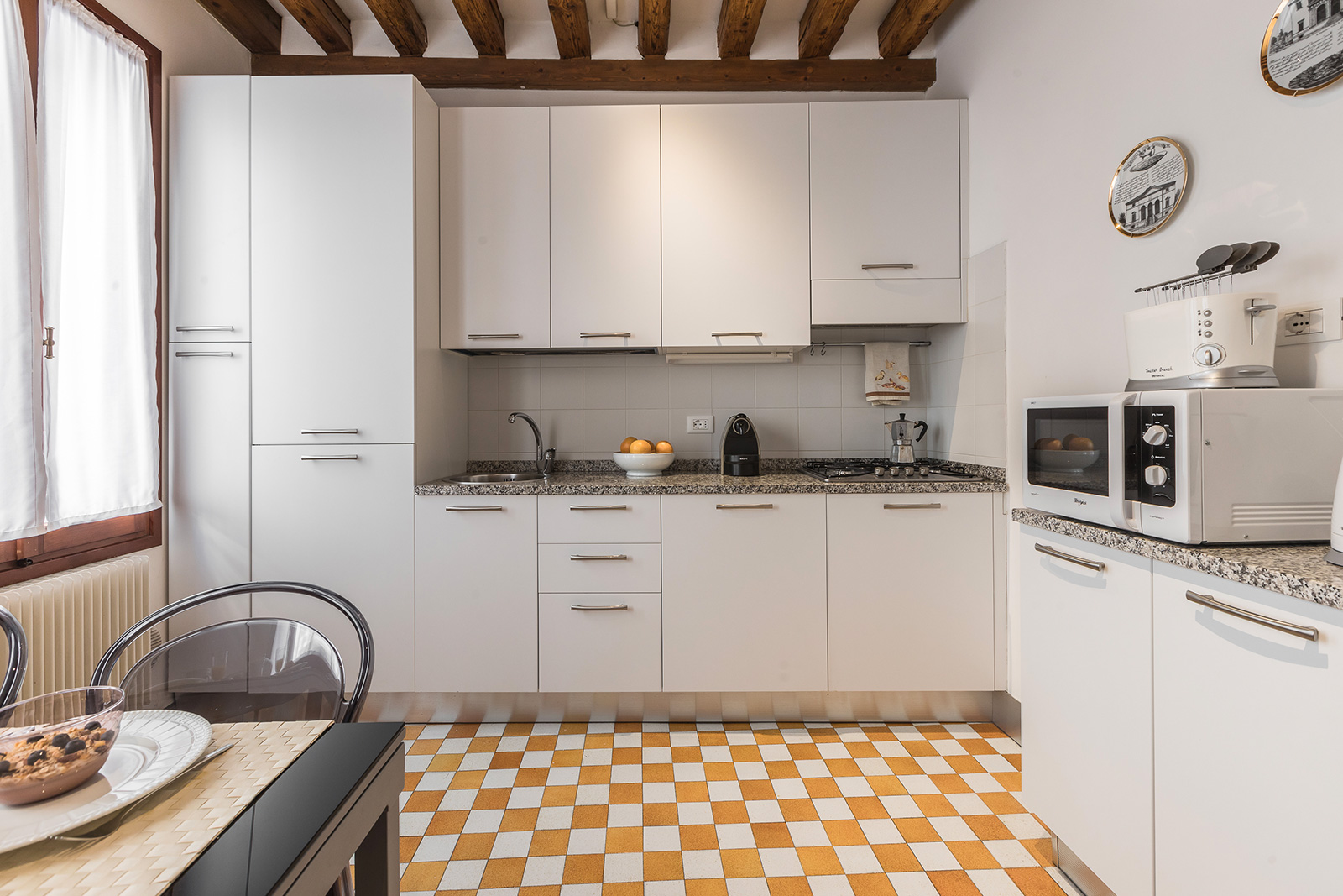 the kitchen is very bright and fully equipped and spacious
