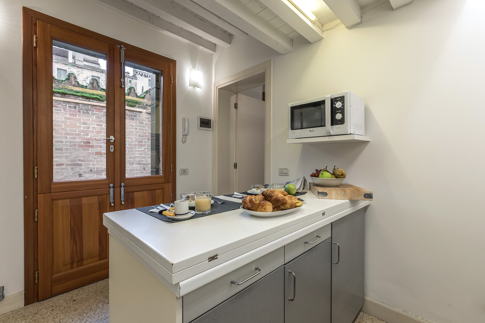 the main entrance of the apartment is from the kitchen
