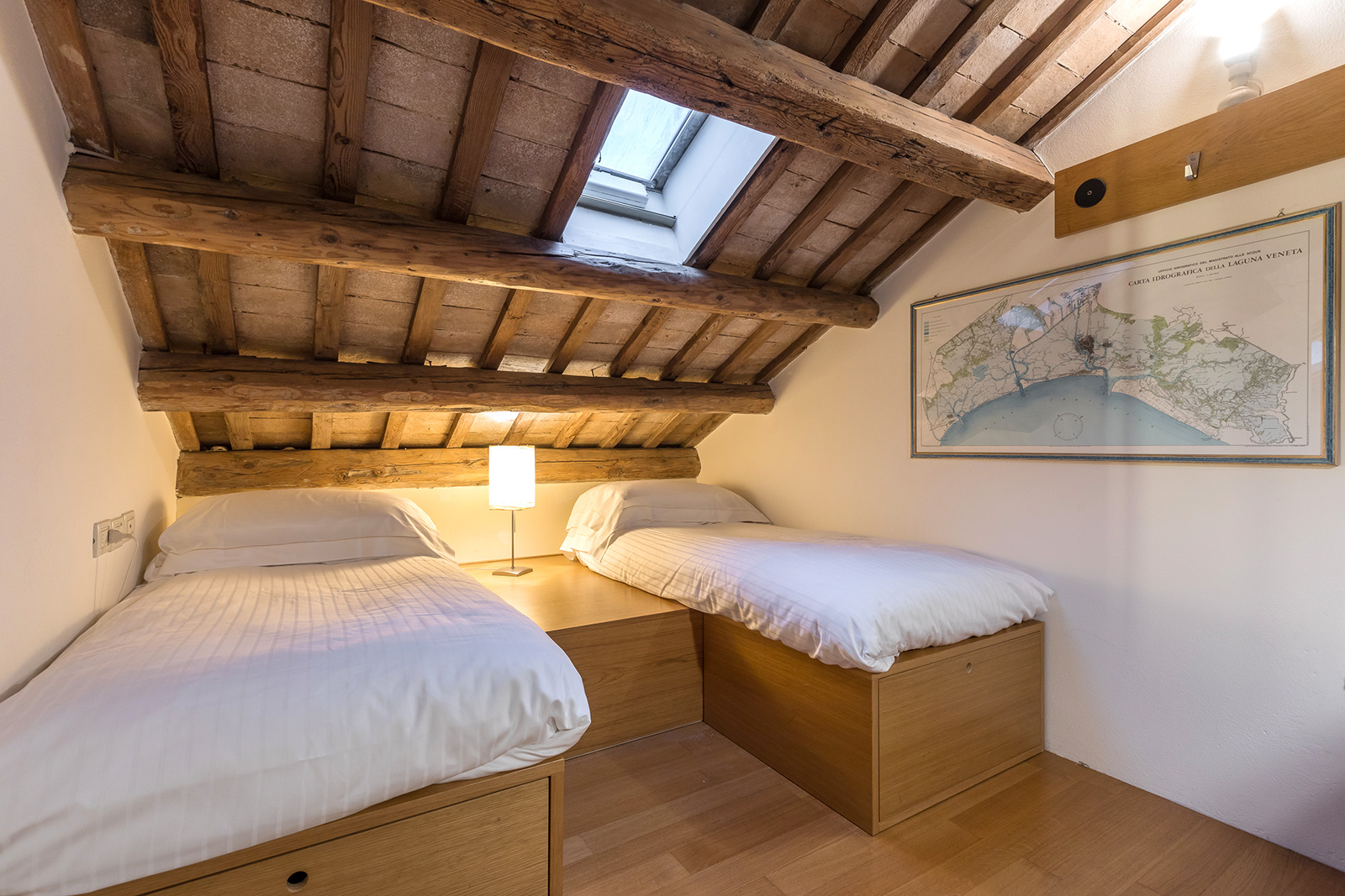 in the attic room there is a large futon that can be used as 2 single beds...