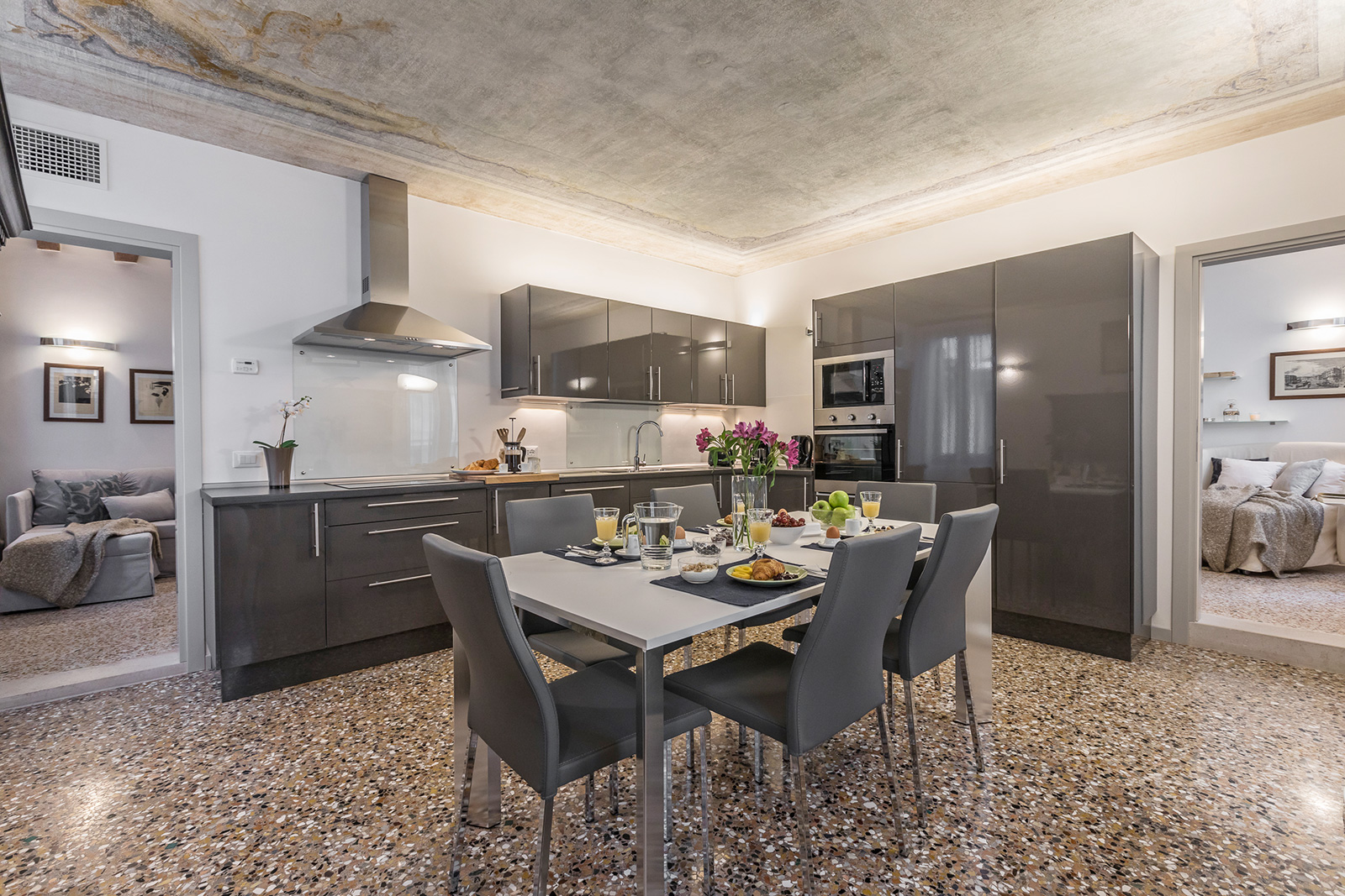 the spacious Petrarca apartment dining room is also connected to the living room