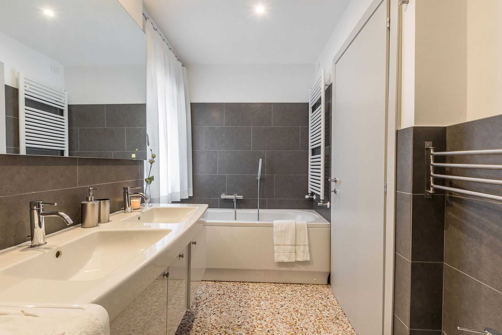 larger bathroom with bathtub
