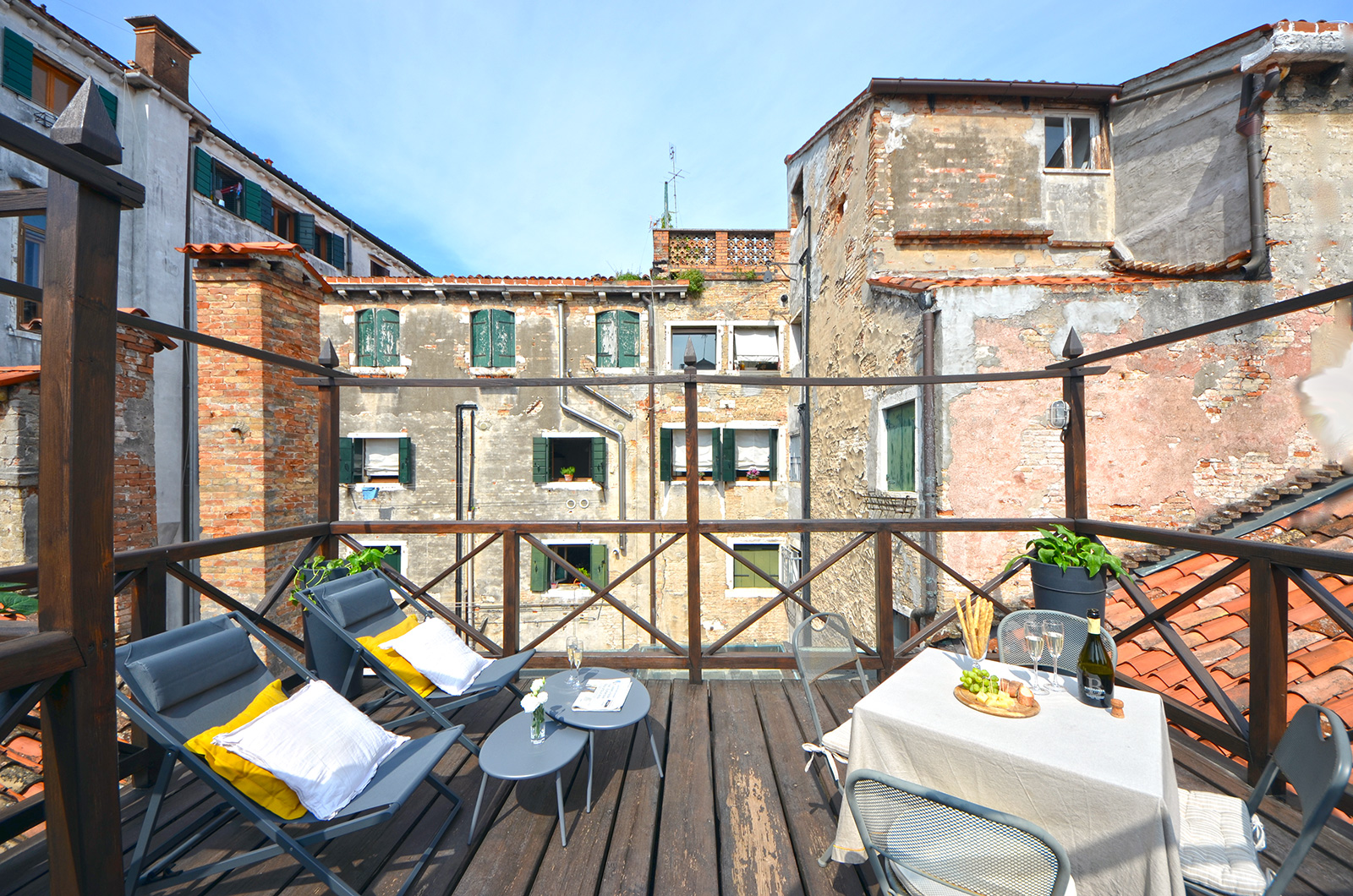 the terrace is very spacious and furnished with sun chairs and table