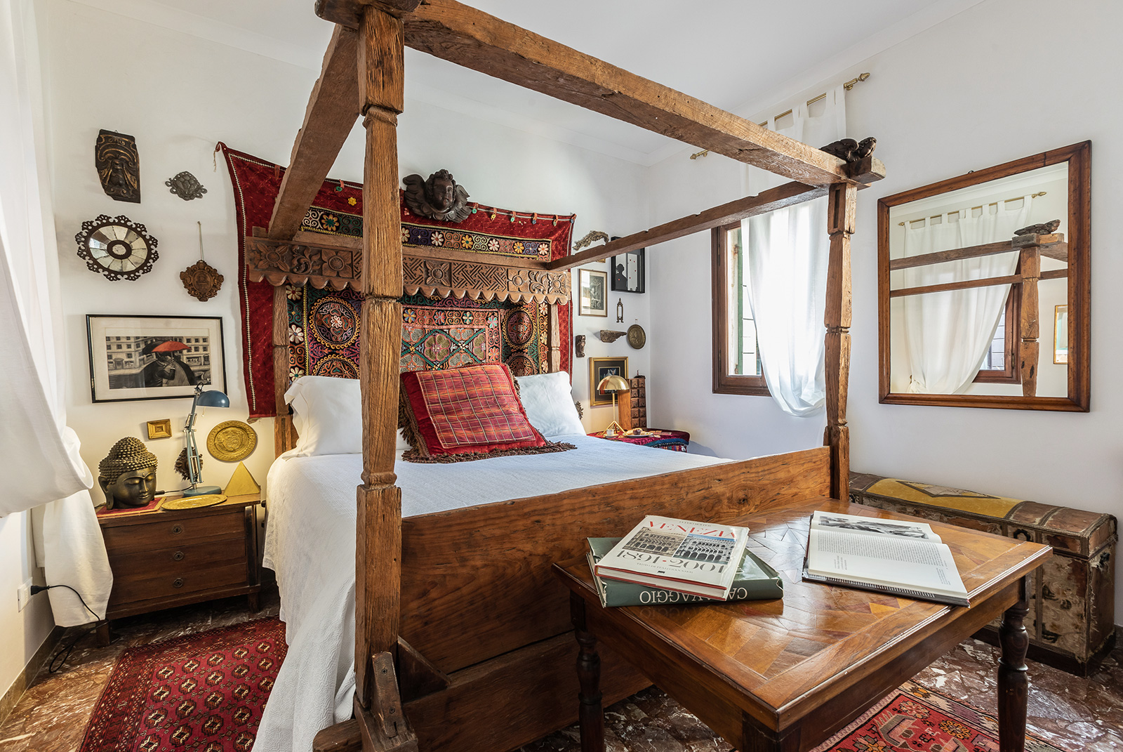 double bedroom at the 1st floor with antique wooden baldachin